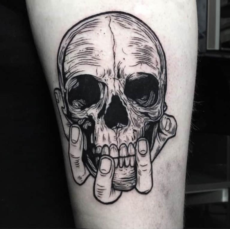 Skull in Hand Blackwork Tattoo