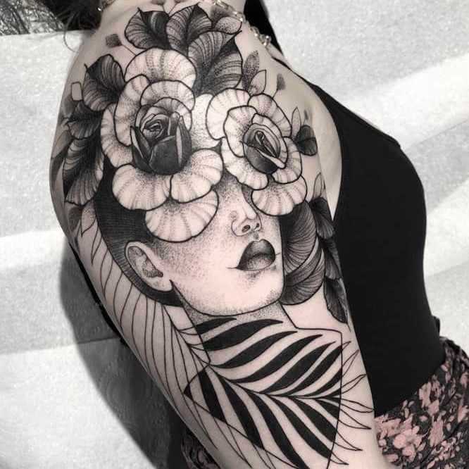 Woman with flowers blackwork tattoo